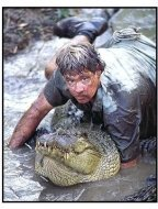 "The Crocodile Hunter: Collision Course movie still: Steve Irwin tackles a 12-foot ""saltie"" in the mud"