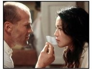 "The Transporter movie still: Frank (Jason Statham) makes things a little more comfortable for his latest package, Lai (Shu Qi) in ""The Transporter"""