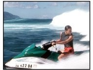 Blue Crush movie still: Eden (Michelle Rodriguez) is chased by a monster waves as she rides out to rescue Anne Marie