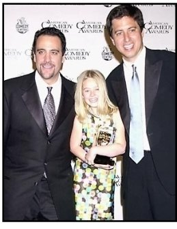 Everybody Loves Raymond cast members Brad Garrett, Madylin Sweeten and Ray Romano backstage at the 2001 American Comedy Awards