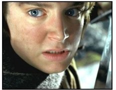 The Lord of the Rings: The Two Towers movie still: Frodo (Elijah Wood) prepares to strike with his sword, Sting in The Lord of the Rings: The Two Towers