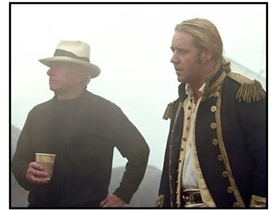 """Master and Commander: The Far Side of the World"" Movie Still:Director Peter Weir and Russell Crowe"